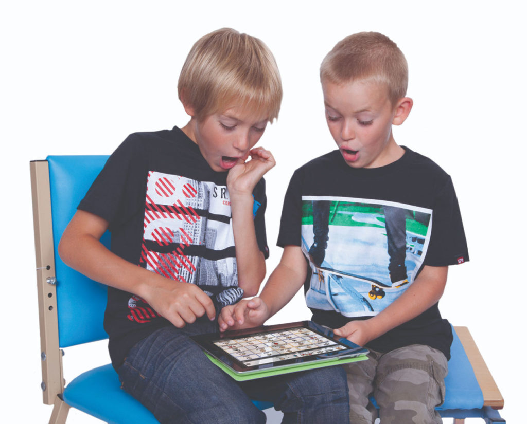 two kids using an augmentative and alternative communication device