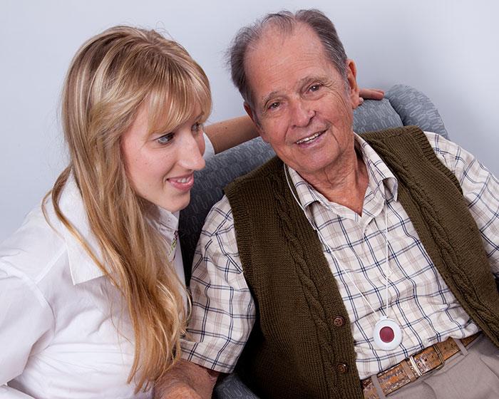 therapist wit an elderly client