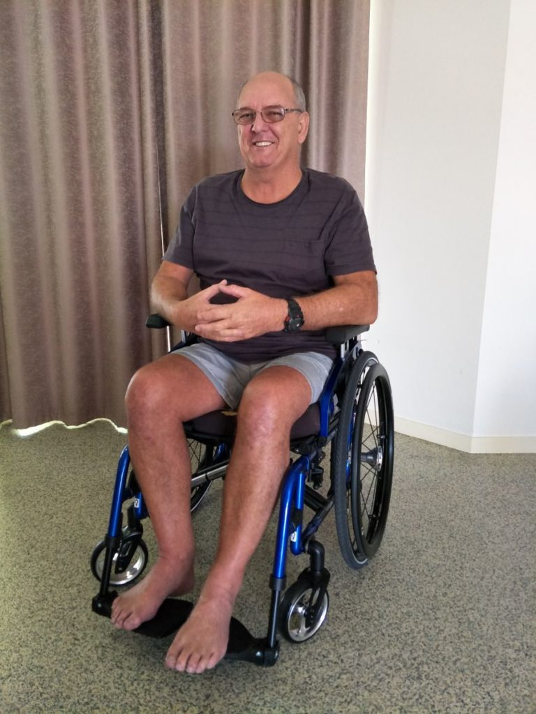 photo of ross in a wheelchair