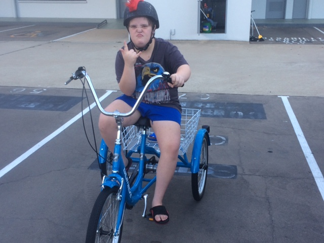 Image of jake on a 2 wheel trike