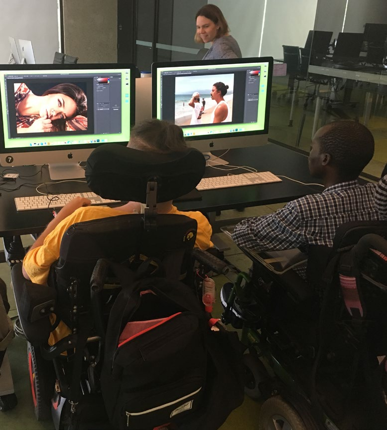 kids with disability participating in the cybersparks pilot project using computer