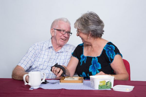 elderly couple using assistive kitchen products