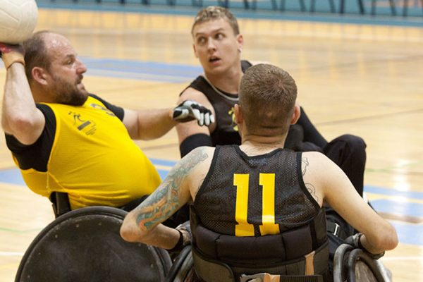 guys in wheelchair playing sports